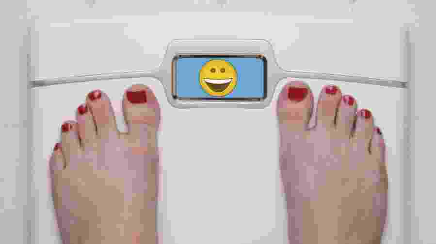 Digital Bathroom Scale Displaying a Happy Emoji