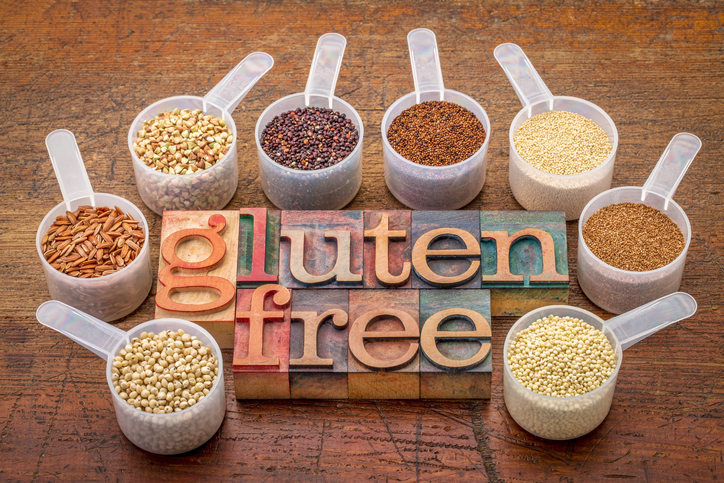 gluten free grains (quinoa, brown rice, kaniwa, amaranth, sorghum, millet, buckwheat, teff) - measuring scoops with a text in letterpress wood type